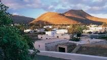 View of Yaiza with El Fuego mountains in the background. Lanzarote © Turespaña