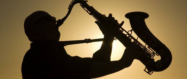 Backlit silhouette of a saxophonist