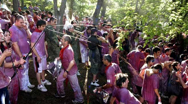 Warriors from the town in La Rioja taking part in the joyful Wine Battle, in which they drench each other with wine © EFE