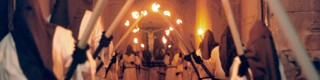 Penitents carrying candles during Easter Week in Orihuela © Rafa Pérez and others. Patronato de Turismo de la Costa Blanca