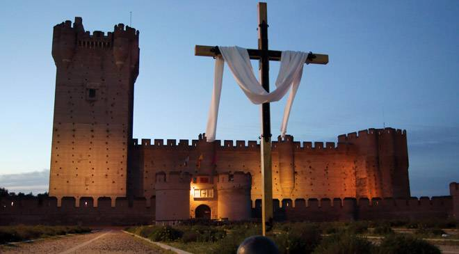 Castle of La Mota with a cross in Easter week in Medina del Campo.