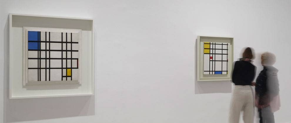 View of the exhibition Mondrian and De Stijl. Reina Sofía National Art Museum. From left to right: Rhythm of Black Lines and Picture II 1936-43, with Yellow, Red and Blue (Piet Mondrian). © Joaquín Cortés/Román Lores. Photography archive of the Reina Sofia National Art Museum.