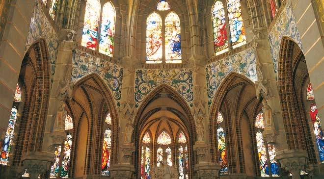 View of the interior of the Episcopal Palace with its spectacular stained-glass windows. Astorga © Turespaña