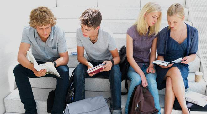 Students sitting on some steps