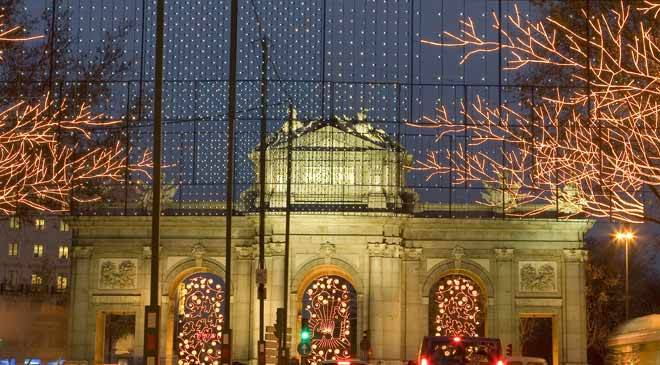 View of the Puerta de Alcalá arch, with Christmas lights. Madrid © Turespaña