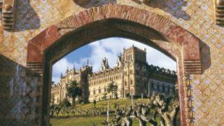 Decorated access doors, with the Comillas Pontifical University in the background. Comillas, Cantabria © Turespaña